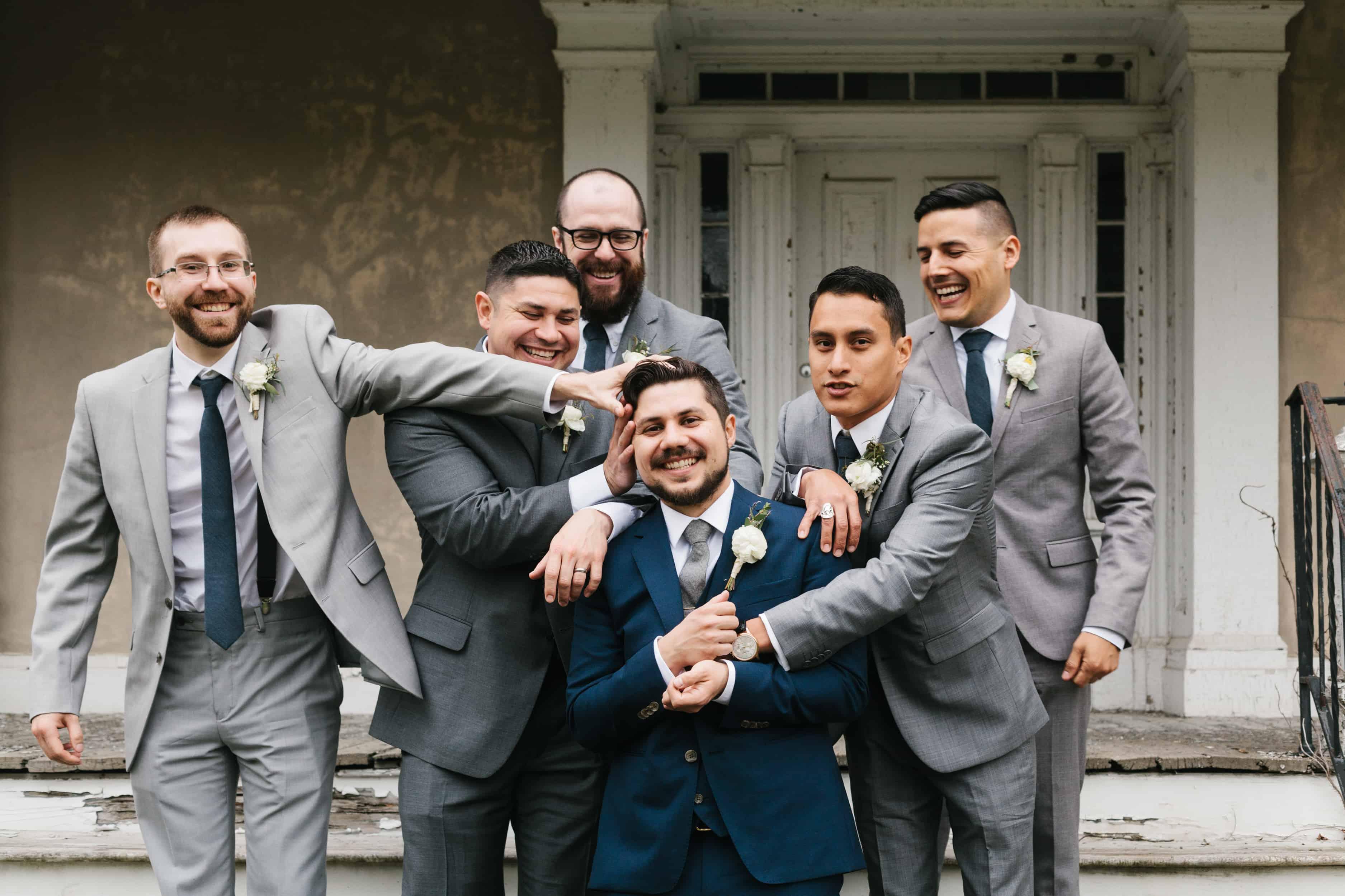 outdoor groomsmen wedding party